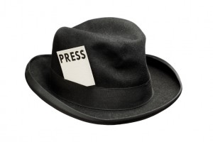 Old fedora felt hat with a press card